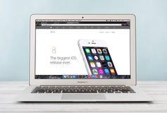 Apple MacBook Air Early 2014. KIEV, UKRAINE - JANUARY 29, 2015: Brand new Apple MacBook Air Early 2014 with home page of Apple Inc. site presenting new iOS 8 on Stock Image