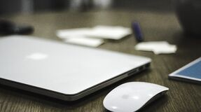 Apple macbook on desk Stock Photo