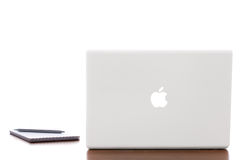 Apple MacBook Mac laptop. Apple macbook laptop on a wooden desk royalty free stock images