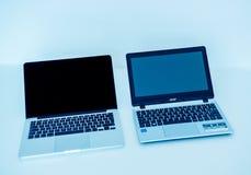 Apple MacBook Pro e Acer aspirano parallelamente PC del computer portatile Fotografie Stock