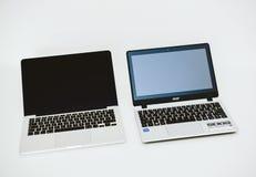 Apple MacBook Pro e Acer aspirano parallelamente PC del computer portatile Fotografie Stock Libere da Diritti