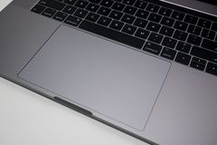 Apple MacBook Pro 15 inch laptop / notebook computer keyboard and trackpad stock image