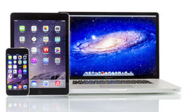 Apple Macbook Pro, iPad Air 2 and iPhone 6 Royalty Free Stock Photography