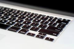 Apple Macbook Pro 2014 Keyboard close-up. Close-up view of Apple Macbook Pro 15`` 2014 model keyboard, with focus on Enter key. Visible Command, Option, shift Royalty Free Stock Photography