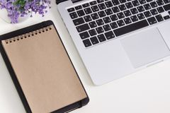 Apple Macbook Pro Retina on a desk with stationery. Mockup for decal, sticker design. Trendy office, freelance workplace.  Royalty Free Stock Photo