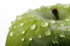 Apple macro. With waterdrops isolated royalty free stock image