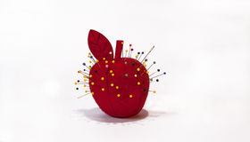 Apple pin cushion Stock Photos