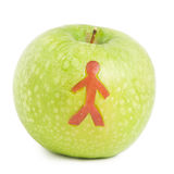 Apple with man silhouette Royalty Free Stock Images
