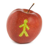 Apple with man solhouette. Red apple with man solhouette Stock Photo