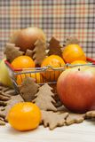Apple, mandarins, christmas cookies in the shopping cart Stock Photography
