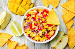 Apple mango salsa. On a white background wood. toning. selective Focus Royalty Free Stock Photography