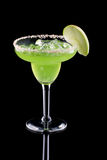 Apple Margarita - Most popular cocktails series. Apple Margarita in chilled glass over black background on reflection surface, garnished slice of green apple royalty free stock photos