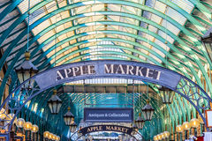 Apple Market Sign at Covent Garden. Pple Market Sign at Covent Garden, London. Apple Market is a popular destination for tourists and Londoners, where traders Stock Images