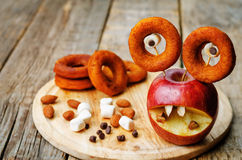 Apple, marshmallows and donuts in the shape of monsters for Hall Stock Images