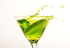 Apple Martini. Apple splashing into Apple Martini Stock Photography