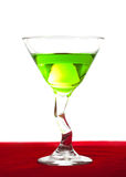 Apple Martini. Close-up of apple martini in glass on red velvet against a white background Royalty Free Stock Photos