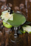 Apple Martini in glasses on wooden background Stock Photo