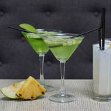 Apple martini and pina colada cocktails Royalty Free Stock Image