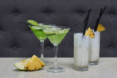 Apple martini and pina colada cocktails Stock Image