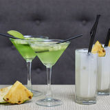 Apple martini and pina colada cocktails Royalty Free Stock Images