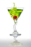 Apple Martini. Splash,  on white with a gradient reflection Royalty Free Stock Photo