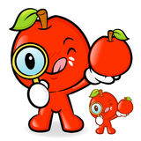 Apple mascot examine a with a magnifying glass. Fruit Character Stock Photo