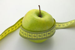 Apple with measuirng tape Royalty Free Stock Photos