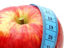 Apple with Measure. Red Apple with Measure Tape on White Background Royalty Free Stock Image