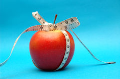 Apple with measure ribbon Stock Image