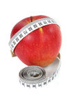 Apple and a measure tape Stock Photos