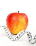 Apple and a measure tape Stock Images