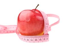 Apple with measure tape Stock Images