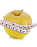 Apple and a measure tape Royalty Free Stock Images