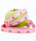 Apple and a Measure Tape. Diet concept Stock Image