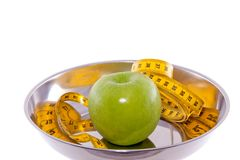 An apple with measure tape Stock Photo