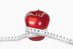 Apple and a measure tape Stock Image