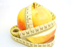 Apple with measure tape #2. On white background royalty free stock image