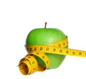 Apple with measure tape Stock Image