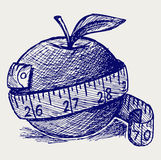 Apple and measure tape Stock Photography