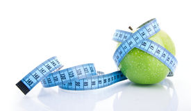 Apple with measure tape Stock Photos