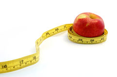 Apple with measure tape royalty free stock photography