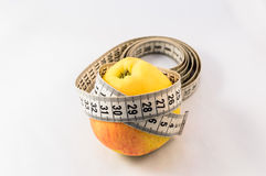 Apple and measure tape Royalty Free Stock Photography