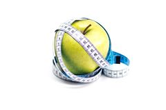Apple with measure tape Royalty Free Stock Photo