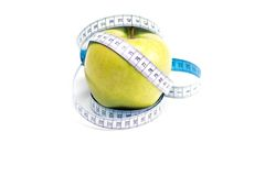 Apple with measure tape Royalty Free Stock Image