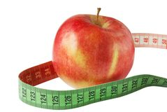 Apple with measure tape isolated Royalty Free Stock Photo