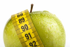 Apple with Measure Tape Stock Photo
