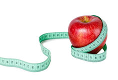 Apple with measurement. On white background Royalty Free Stock Images