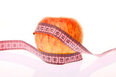 Apple and measurement tape Royalty Free Stock Images