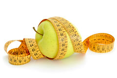 Apple and measurement tape. On white background Stock Images