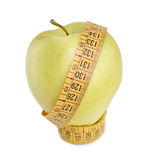 Apple and measurement tape. On white background Royalty Free Stock Images